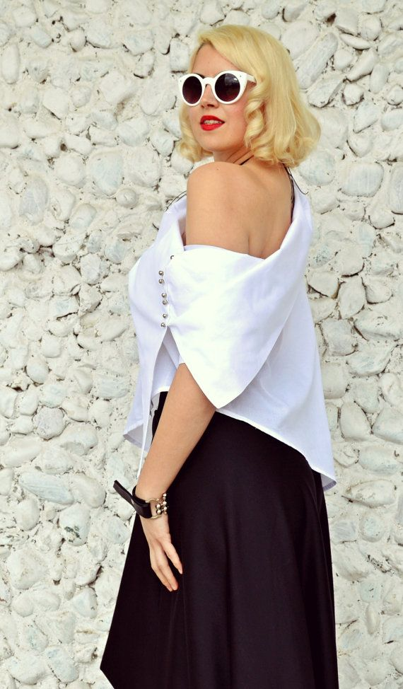 Extravagant white top made of pure cotton with an asymmetrical cut and a large collar that is both elegant and comfortable. The fabric is amazing and it feels soft and light, being a perfect choice for those hot summer days. Being slightly sheer it adds a bit of mystery to you look, being sensual at the same time. Pants in the photos: https://www.etsy.com/listing/287178299/black-jersey-drop-crotch-pants-harem  Material: 95% Cotton, 5% Elastane Care instructions: Wash ...