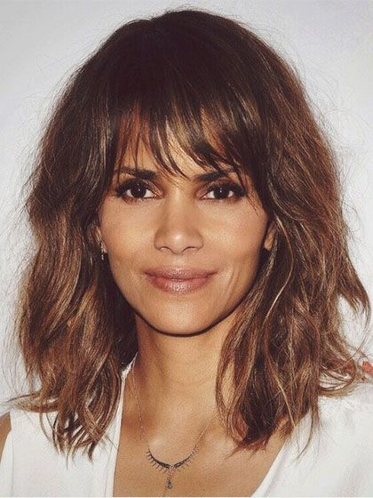 "Halle Berry  Berry's full, tousled chop looks good on just about everyone, which is why it's so popular right now. ""This is a lighter bang—you want all those messy pieces,"" says Fugate. ""There should be no bluntness in the cut. Only disheveled, touchable, cotton-candy texture you can scrunch and touch,"" he adds."