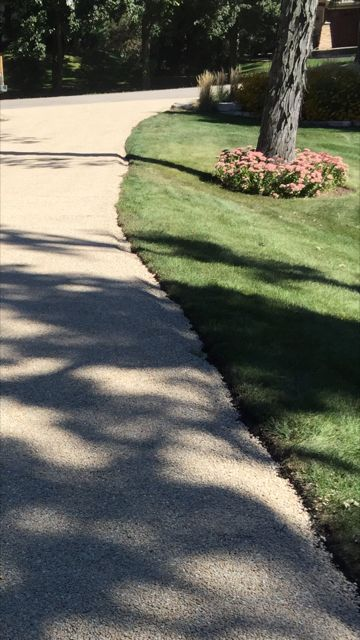 In about a month or so we will come back and install an edge on the driveway with landscaping pavers or natural limestone.   For more information on where you can get a tar and chip driveway in the Chicagoland area check out our web site below:      #tarandchipdriveway