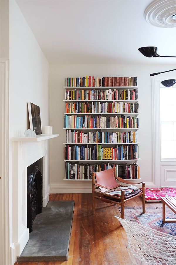 floating shelves for books - possibly on left side wall in family room