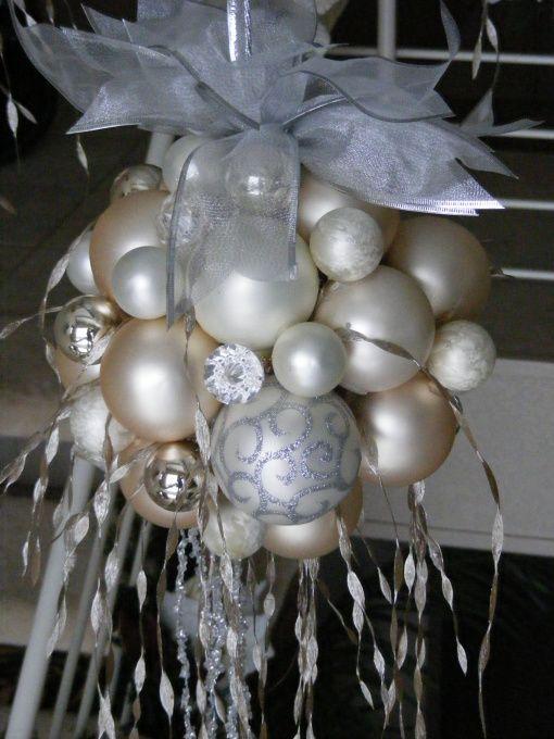 Hot glue ornaments to a foam ball.