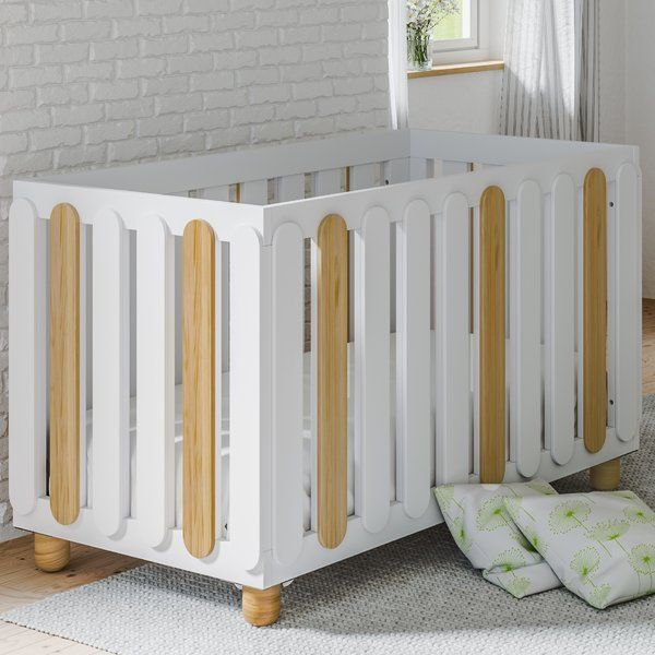 With groundbreaking contemporary design, the Status Sienna 3-in-1 Convertible Crib will be the benchmark for all modern nurseries to come. The Sienna crib features wide slats and rounded feet for a unique, upscale look that will elevate your baby's room. With a three-position adjustable mattress base to accommodate your growing child, the Status Sienna crib also converts to a toddler bed (no guard rail required) and daybed. The Status Sienna 3-in-1 Convertible Crib is certified by the…