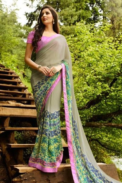 Grab the attention of your onlookers by cladding in this multi color vibrant printed party wear georgette fabric saree adorned elegantly with fancy print and lace work which is the main highlight of the saree This saree is an apt choice of outfit for casual parties and social events when paired with simple fashionable jewellery The saree comes along with matching fabric unstitched blouse piece that can be custom made upto the bust size of 42 inches