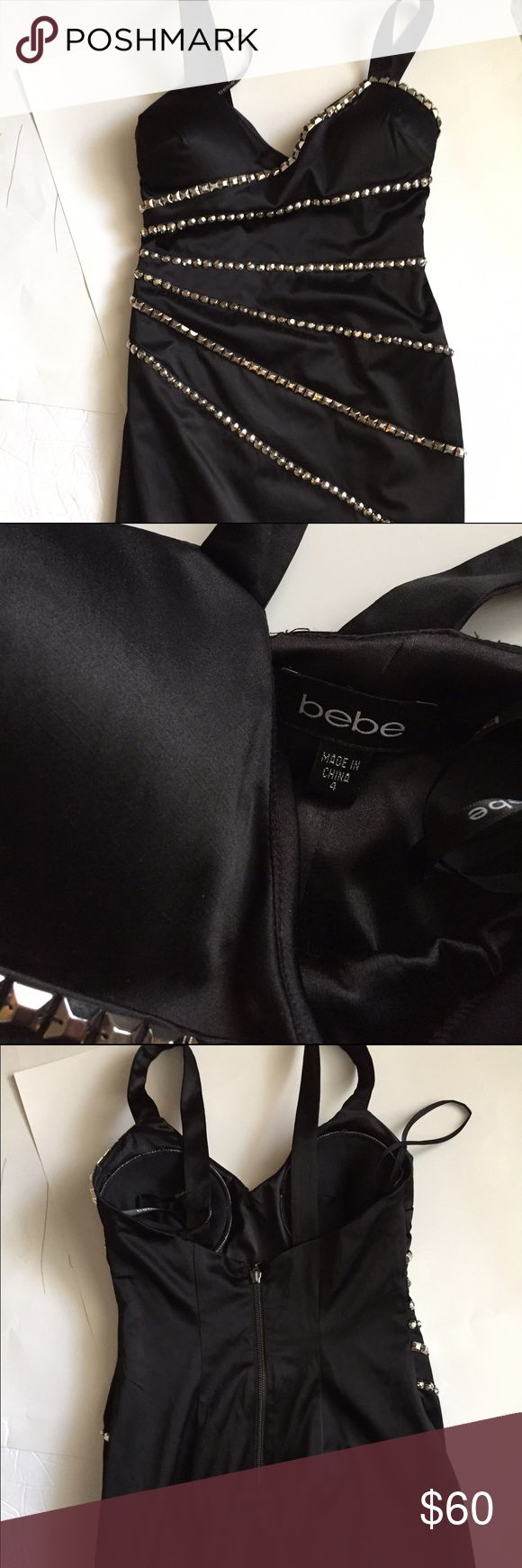 Bebe Black Dress!  Bebe Black sexy dress embellished with silver toned studs! 30 inches long! Bust padding! Back outer zipper! Great condition! Everyone needs a little black going out dress! bebe Dresses Midi