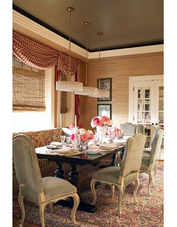 Layered Curtains  -- Love the plaid curtains with the natural roll up shades!  Great mix of pattern.