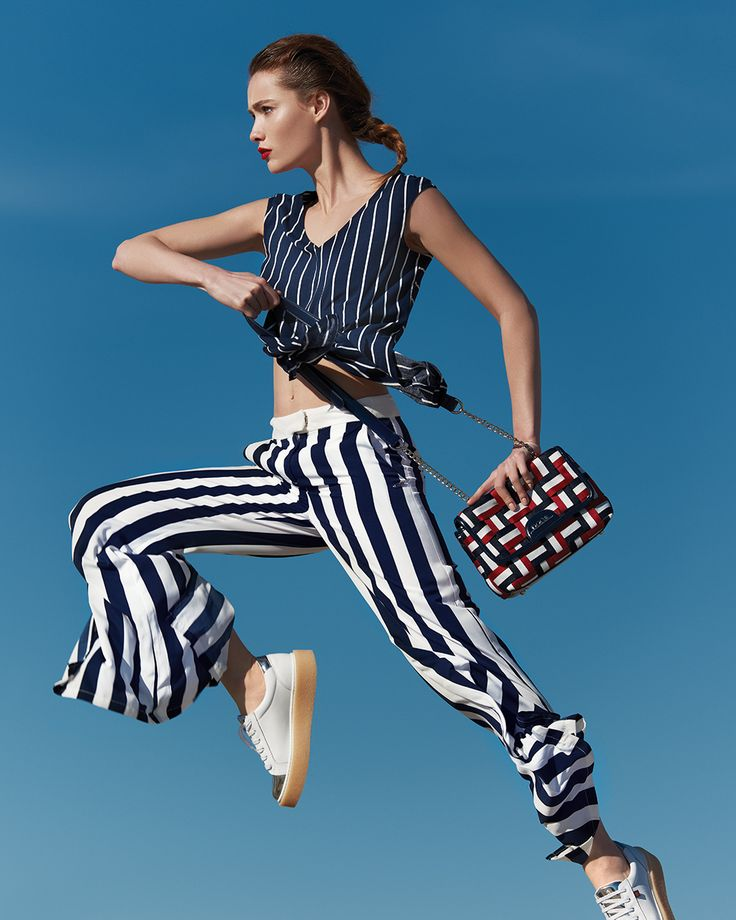 The Saltmarine Trend The classic navy stripes reinvent themselves and get inspired of digital waves and modern art silhouettes. High waist striped trousers, long cotton shirtdresses and jumpsuits combined with metallic sneakers, create the new sporty chic attitude of this trend. Add extra glam to your outfit with accessories in shades of red, blue or white, and stand out in style. #doca #ss17 #campaign #fashion #marine #nautical #stripes