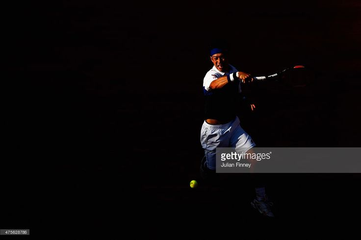 Kei Nishikori of Japan returns a shot during his Men's quarter final match against Jo-Wilfried Tsonga of France on day of the 2015 French Open at Roland Garros on June 2, 2015 in Paris, France.
