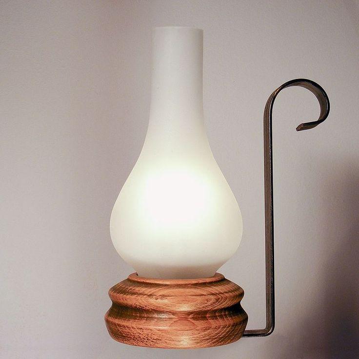 VELA table lamp wood base wrought iron arm and matt glass lampshade http://rustiklight.com/lights/table-lamps/vela-table-lamp #wood #lighting #home #homedecor #homedeco #homedesign #interiordesign #lights