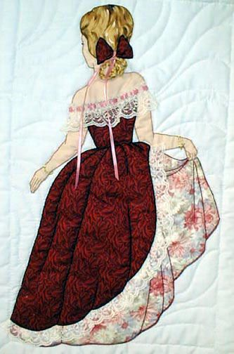 """#8 """"Bonnet Girl Relatives & Friends"""" Elizabeth $6.50.  Elizabeth is holding her skirt to keep the appliqué lace trim out of the dirt.  Her embroidery hair is trimmed with an appliqué bow and ribbon."""