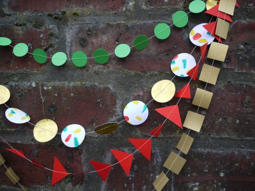 Buddy multi-strand garland - available in our Christmas shop! Gold holographic card that we paint with a fun and festive red, yellow and green!  Luxury handmade paper decor by Paper Street Dolls  Check out our store - paperstreetdolls.etsy.com