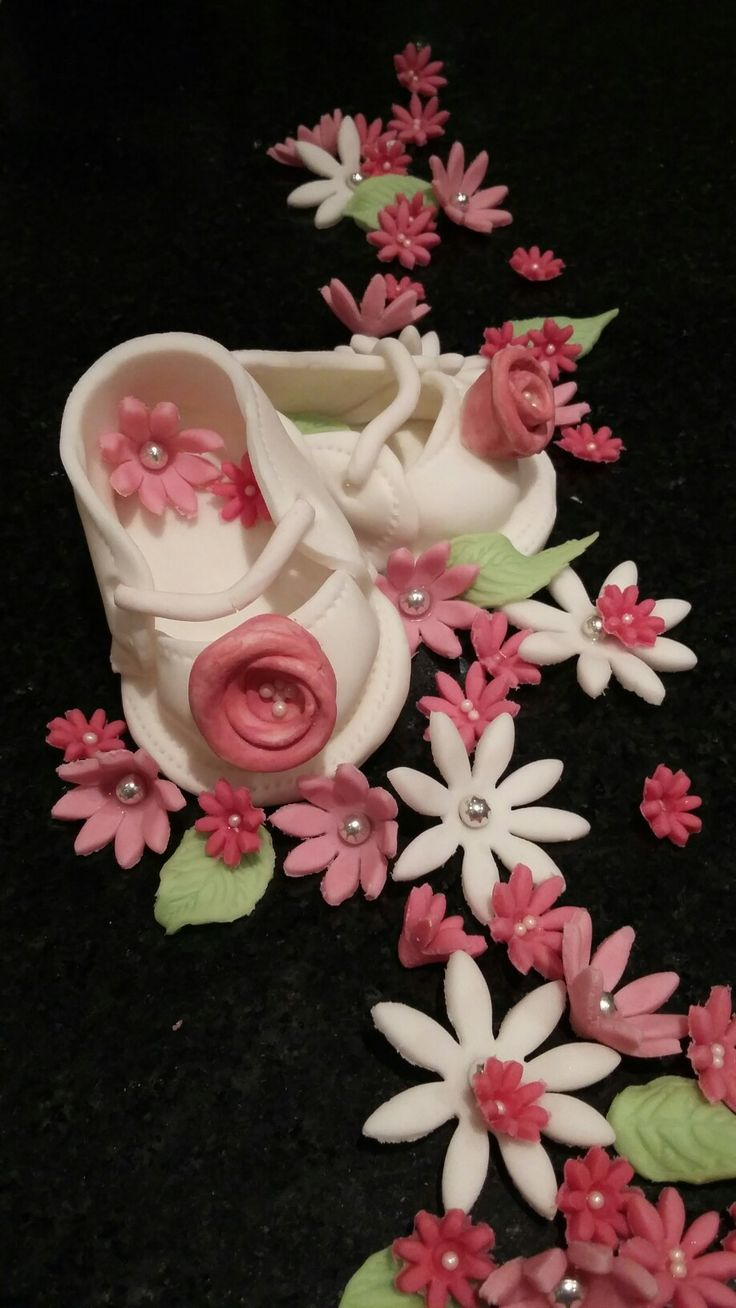 Fondant booties and flowers, baby girl by Danielle Smith ( Rockylicious Cakes )