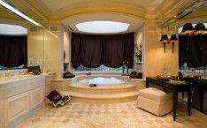 Luxurious Bathroom Designed With Modern Bathtub And Shelf
