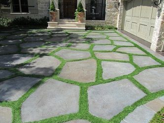 synthetic grass + recycled concrete chunks