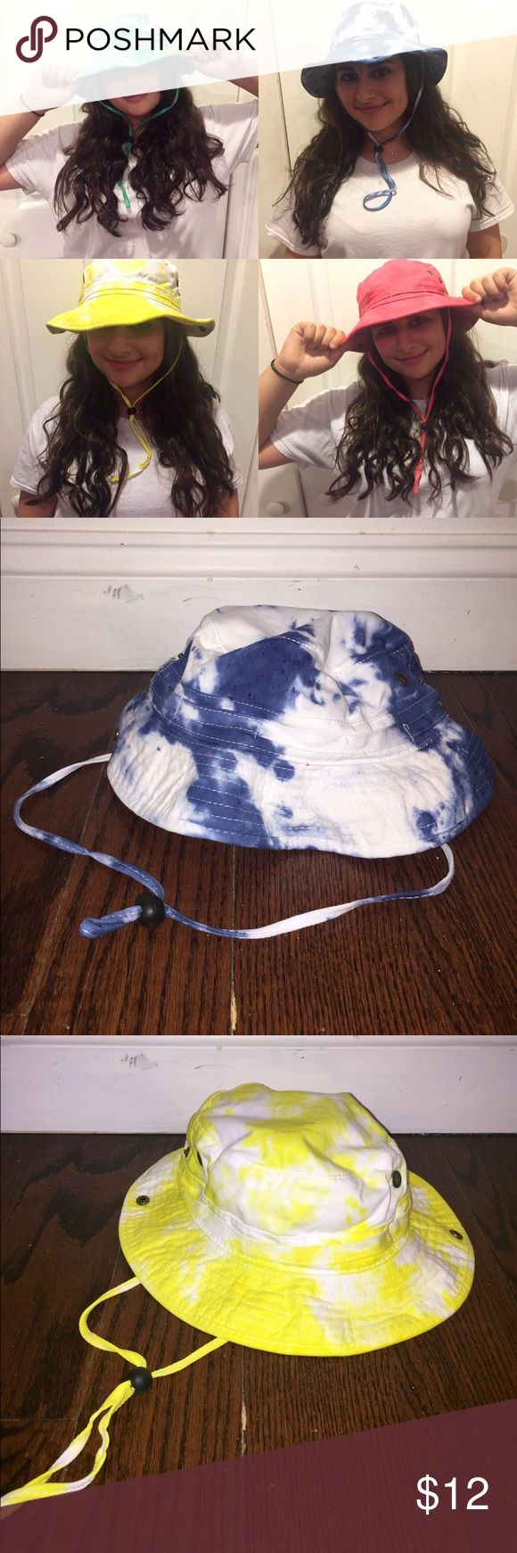 Tie Dye Bucket Hat with String (Festival wear) Fashion Cotton Bucket Hats Caps with String Self-fabric Chin Cord, 4 Big Meshed Brass Eyelet and Side Snaps. Fits best from hat size Medium to Large. Aprox 58cm. Crown: 3 Inches, Brim: 2.5 Inches. 100% Cotton. Made in China. Tag: Bucket with string. ***Available in blue, red, yellow, or green. When purchasing let me know what color :)*** Accessories Hats