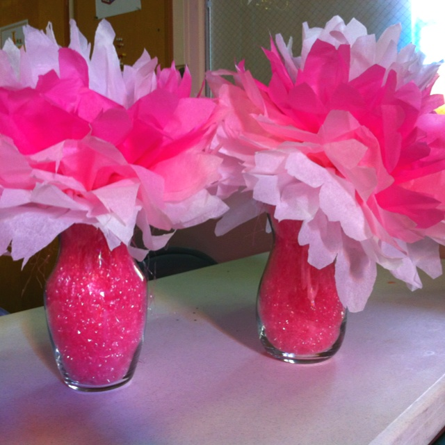 For grandma's 80th birthday. Vases found at goodwill, Easter grass from goodwill too. 97 cent tissue paper. $3.00 centerpieces.
