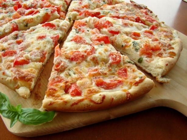 "Shrimp or Lobster Gourmet Pizza: ""This is an excellent pizza! I had to use my rectangle baking stone, as I don't have a large pizza pan. The recipe states it serves 4, but 2 of us polished it off with no problem."" -Lori Mama"