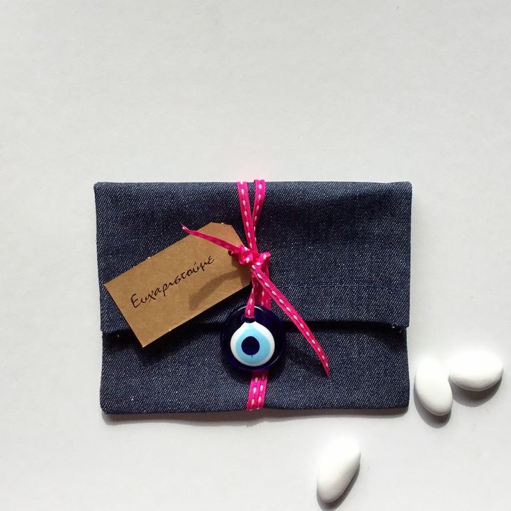 Favour bag, gift bag made from denim with blue glass evil eye charm. Perfect for baby shower, wedding, Easter, baptism, party.