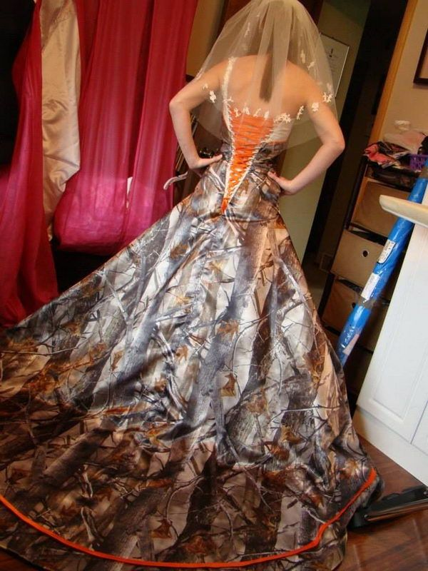 Camouflage Wedding Dress offer a unique twist on the traditional wedding gown. Camo doesn't have to be informal – some designers have created elegant and feminine formal wedding gowns from camouflage fabric.