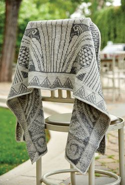 Locking floats in color knitting will help this knit shawl look great on the right side and the wrong side.