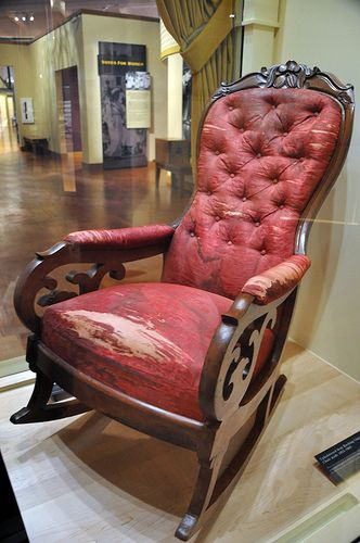 April 14,1865-Blood stains on the chair from Ford's Theatre State Box. Lincoln was sitting in while assassinated by John Wilkes Booth.