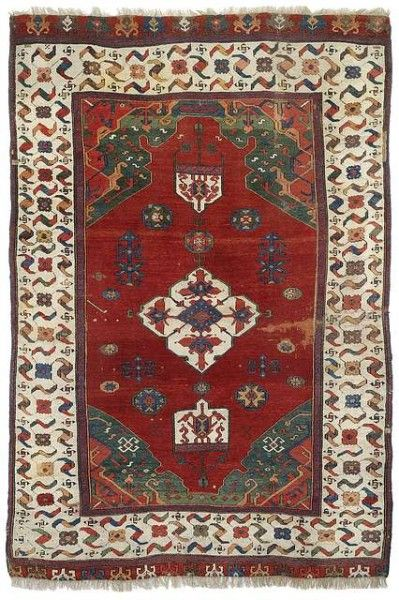 Medaillon UŞAK rug, 16th or 17th century.  Double niche rug with central medallion and lappets at both ends.  225 x 150 cm.