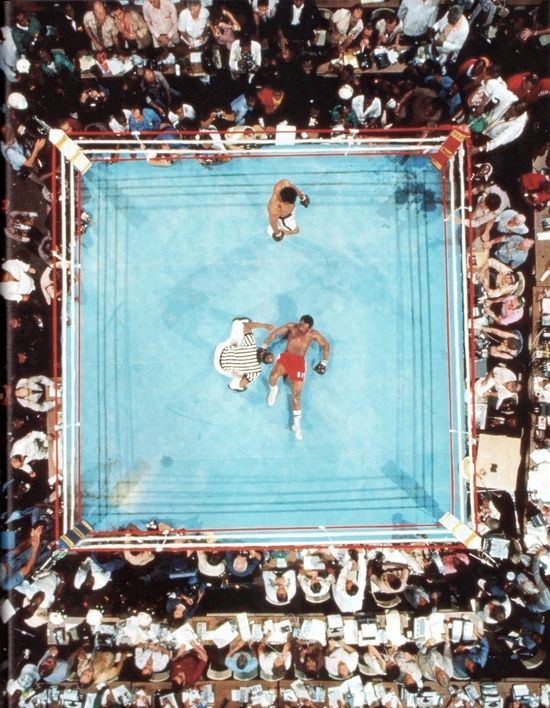 "Muhammad Ali defeats George Foreman at the famous 1974 ""Rumble in the Jungle"" in Kinshasa, Zaire."