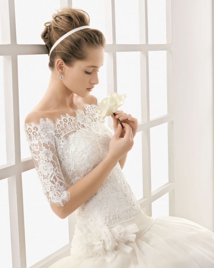 Classic Lace Wedding Dress with Removable Sleeved Bolero. love the top part of this dress and her hair