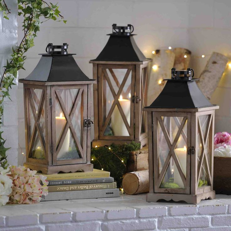 Spring is the perfect time to bring natural textures and natural colors into your home. We suggest decorating with wooden lanterns full of moss and candles. You can also add string lights for an extra special touch!