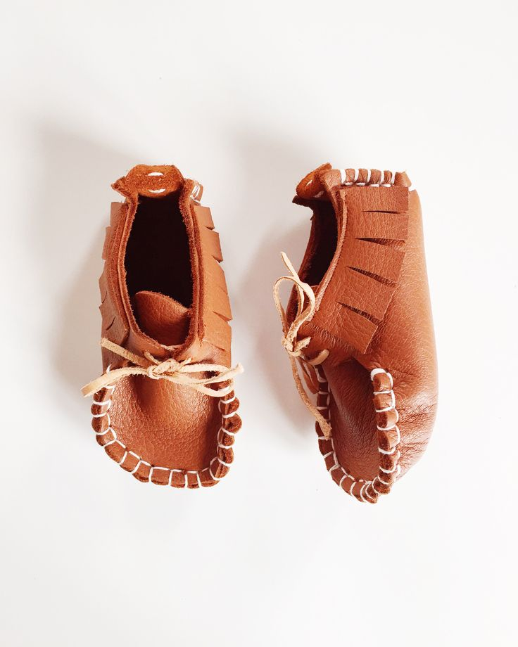 Designed so little feet can still move in their natural way without being restricted in their natural movement, which makes these perfect for little ones learning to walk.Each shoe is hand sewn from beautiful soft high quality Napa Deer Leather and laced with Kangaroo Leather Thonging.SIZES:1: 11.5cm2: 12.5cm3: 13.5cm4: 14.5cmPlease check you have chosen the correct size before confirming purchase.