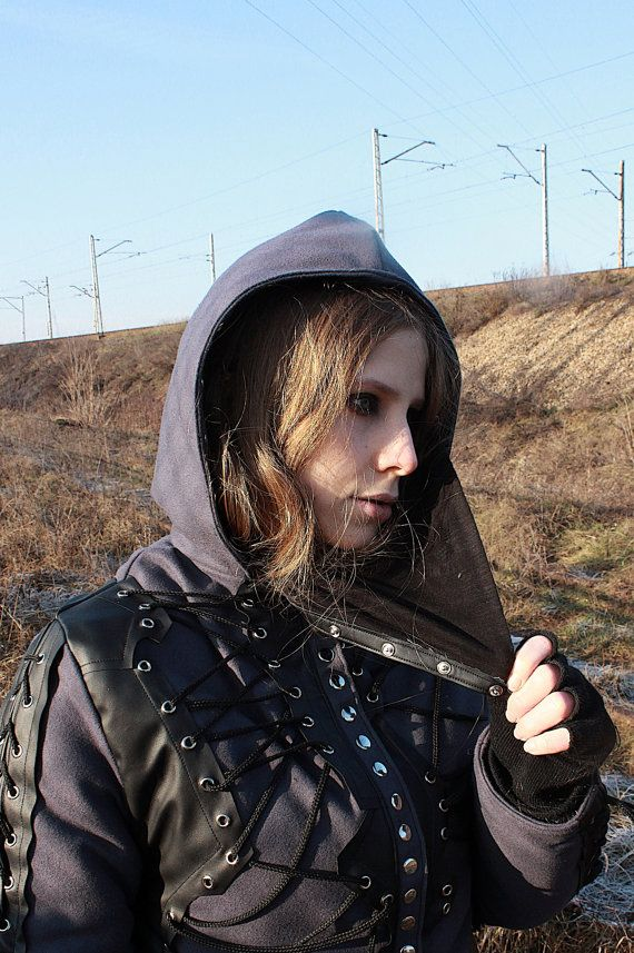 A womens winter jacket with lacing and detachable assassins mask.  Fully handcrafted. One of a kind; the only one in the world like it. As unique as you!!! Made from wool and eco leather & polyester lining.  Bust: up to 95 cm (37,5) Length: 58 cm (23)  FREE SHIPPING WORLDWIDE