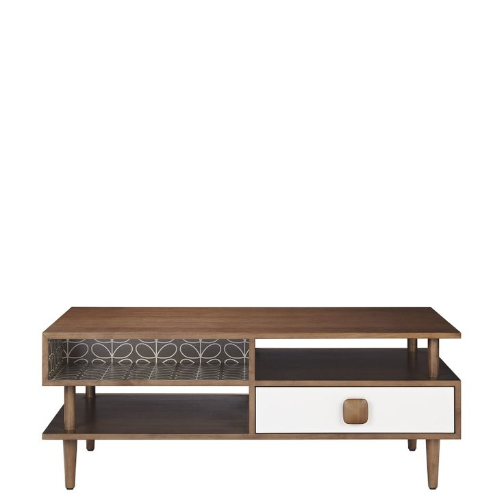 Orla Kiely: Walnut, solid and veneered coffee table with lacquered olive and cream MDF panels. Pebble stem print melamine inlays. With open and closed storage that can be accessed from either side. Fully assembled. For more information please contact our Mercer Street store directly.