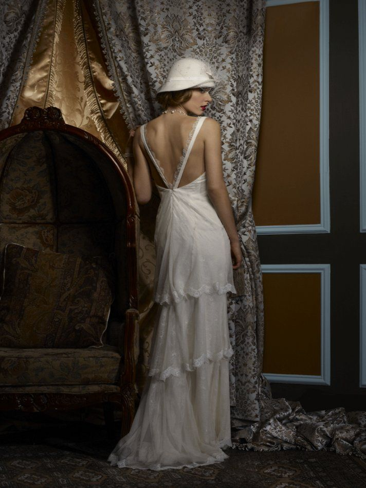 Love the back and tiered skirt on this Birnbaum & Bullock 2013 #wedding dress. Just enough vintage, don't you think?
