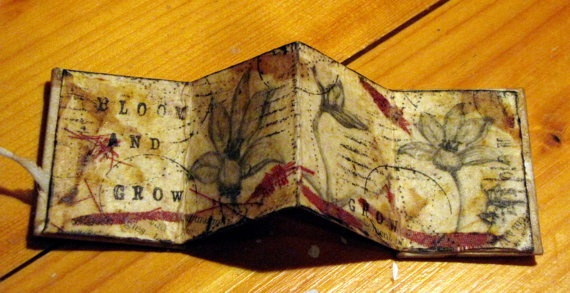 Kim Henkel – miniature accordian book: transfers, bits of fabric, stamps and emptied tea bags