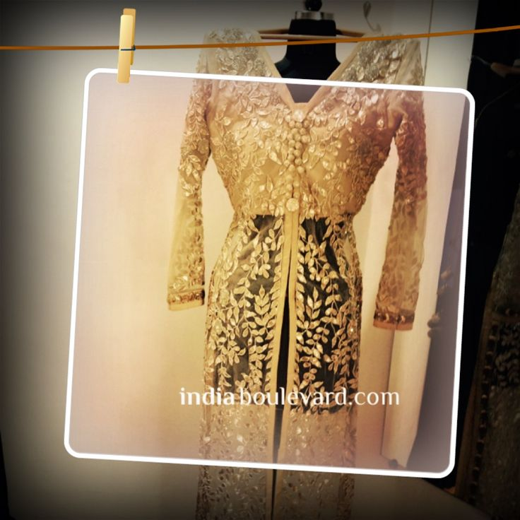 All glitters IS gold! A gold embellished see-through jacket with studded with self-gold embroidery all over! Pair it with a contrast pair of skinny pants and you will definitely sparkle at any event! Share your inspirations with us at indiaboulevard.com or write to us at akta@indiaboulevard.com ‪#‎indiaboulevard‬ ‪#‎allthatglittersisgold‬ ‪#‎gold‬ ‪#‎pakistanicouture‬ ‪#‎indiancouture‬ ‪#‎desifashion‬