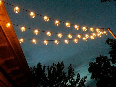 diy garden string lights. patio string lights properly installed on pole - put out by garden beads. from porch rail to and back. diy r