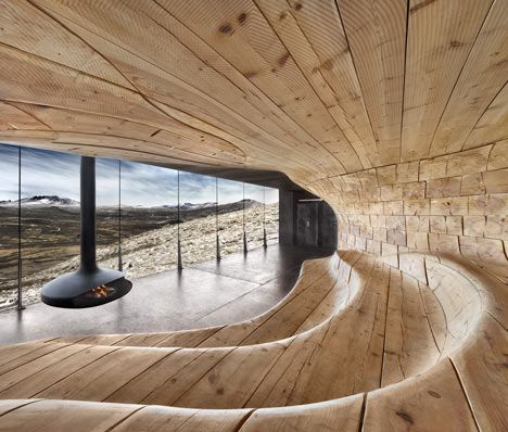 A reindeer observation pavilion with a rippled timber core