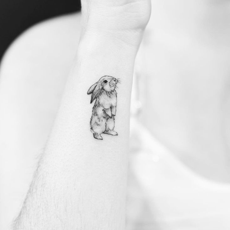 10 adorable, minimal animal tattoos that will inspire you to get inked, like this too cute bunny rabbit. #AnimalTattoos