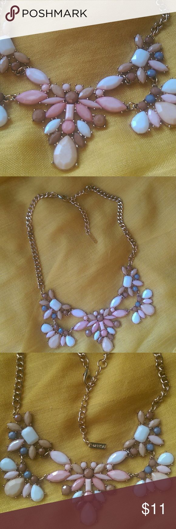 Mika Floral Necklace Gold chain, pastel pink and purple flowers with cream and white accents. Lays flat across the collarbone but is adjustable by about 2 inches of chain. Mika Jewelry Jewelry Necklaces