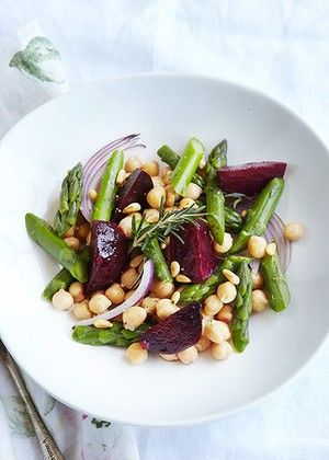 Warm beetroot, asparagus and chickpea salad. 1/2 cup dried chickpeas 3 cloves garlic, peeled 1 large sprig rosemary 8 baby beetroots oil spray 8 asparagus spears 1 red onion 1 tsp olive oil 2 tbsp pine nuts