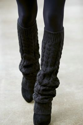 Black leggings, black leg warmers, and black shoes.