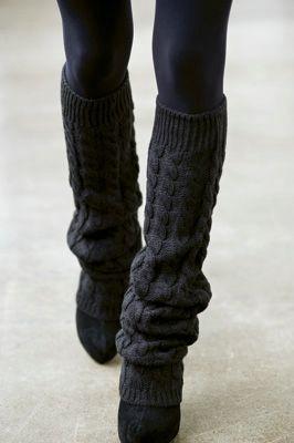 Black leggings, black leg warmers, and black shoes.