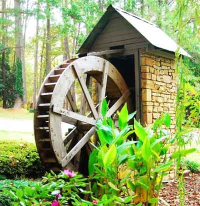 water wheel ..... cute, but I have a difficult time picturing it being very functional.