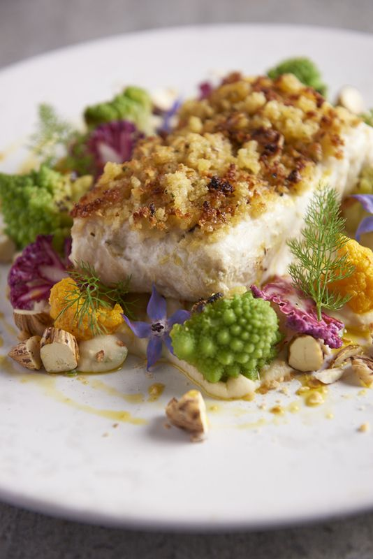 Baked Halibut with cobnut crust, cauliflower and cockles