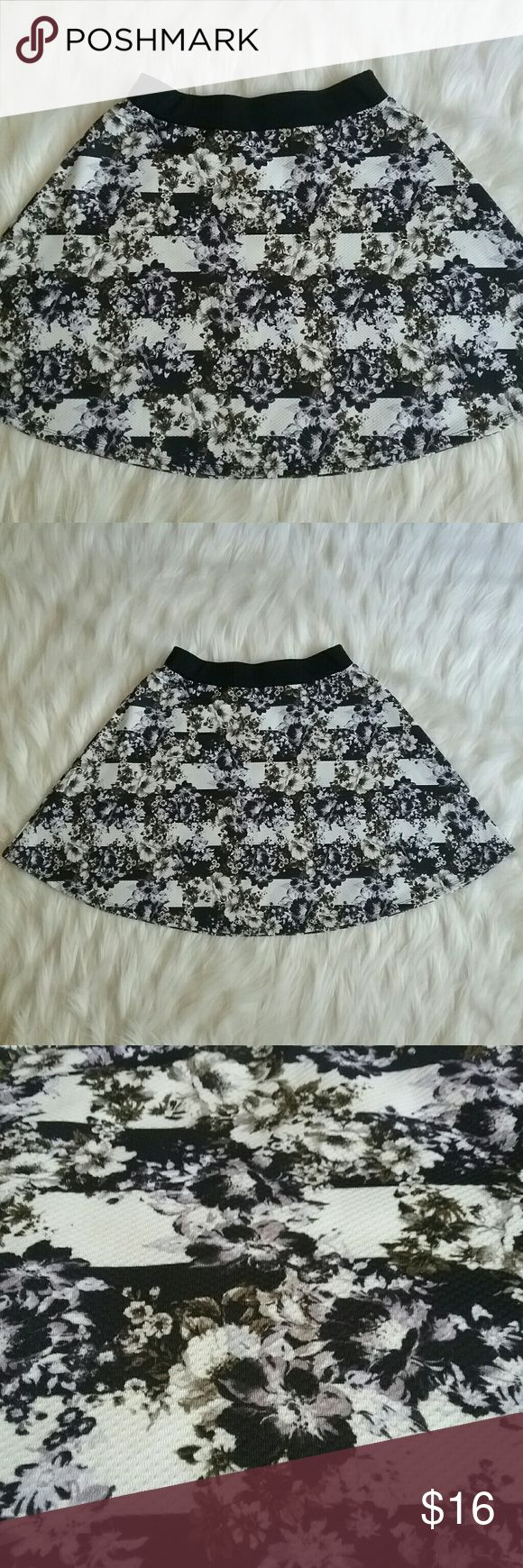 Xhilaration floral twirl skirt Great condition. Stripes & flowers. Size Medium. Subtle purple & green colors in the flowers. Very pretty.  Self: 94% polyester 8% spandex Contrast: 98% cotton 2% spandex Laying flat across the top: 13 inches (elastic..will stretch) Xhilaration Skirts