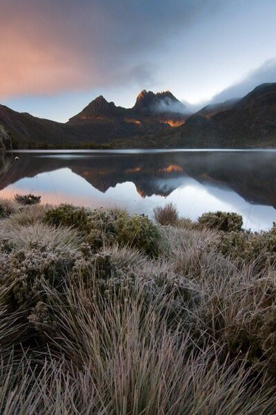 (Cradle Mountain) 6 km ice cap formed and glaciers flowed from its edges carving the landscape into dramatic shapes.The Cradle Mountain area shows geological evidence of three glacial stages over the last 2 million years. Cradle Mountain National Park receives in excess of 200000 visitors each year. I recommend going by horse back at sun set because it is absolutely stunning !!!!