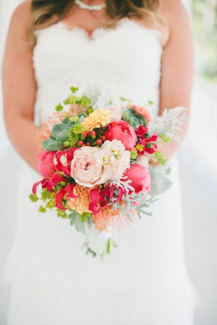 Bridal bouquet by Designer Nicole Boshard of The Petal Pusher – California, with coral charm peonies, gloriosa lilies, peach dahlias, pin cu...