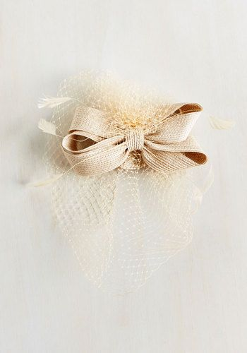 Announcing your arrival with plates of berry-topped cakes, you stroll through the party topped with your own tantalizing tidbit - this neutral fascinator. Adorned with lattice netting and a woven bow, this pretty headpiece is the perfect way to embellish your entrance.
