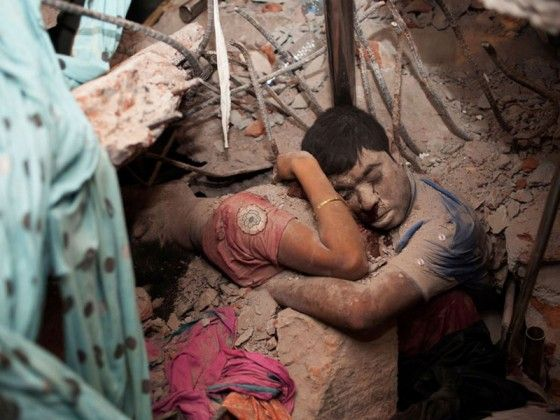 A couple hugging for the last time, during a collapse of a clothing factory.