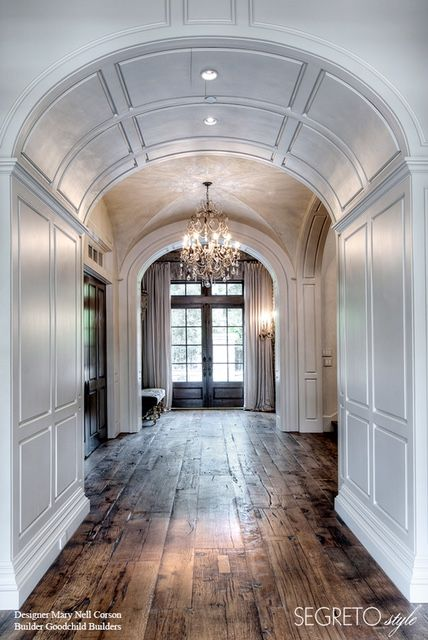 Perfectly gorgeous wood floor , curved wooden walls and chandelier. Lovely hallway that makes a statement