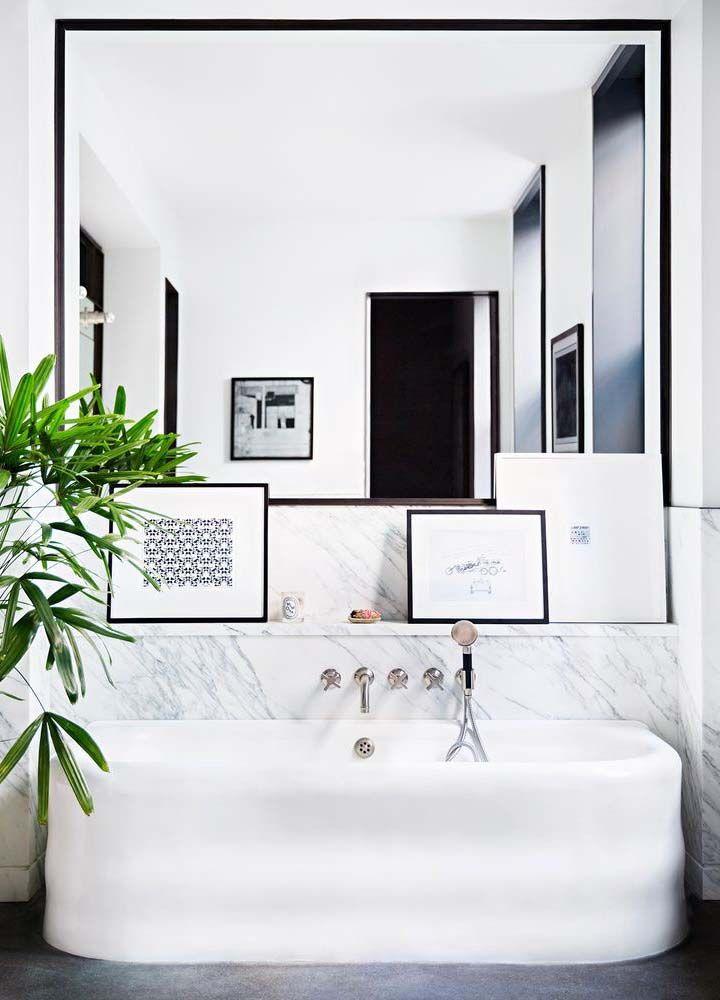 Bathrooms White tub marble black framed mirror